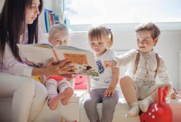 Teacher Reading to Preschoolers