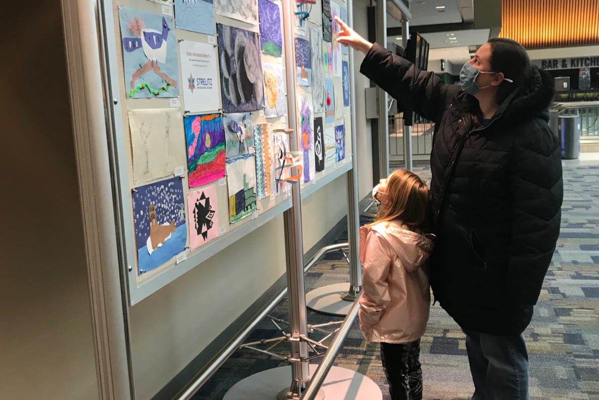 Child with his parent explore the Art Show Gallery at the Norfolk International Airport