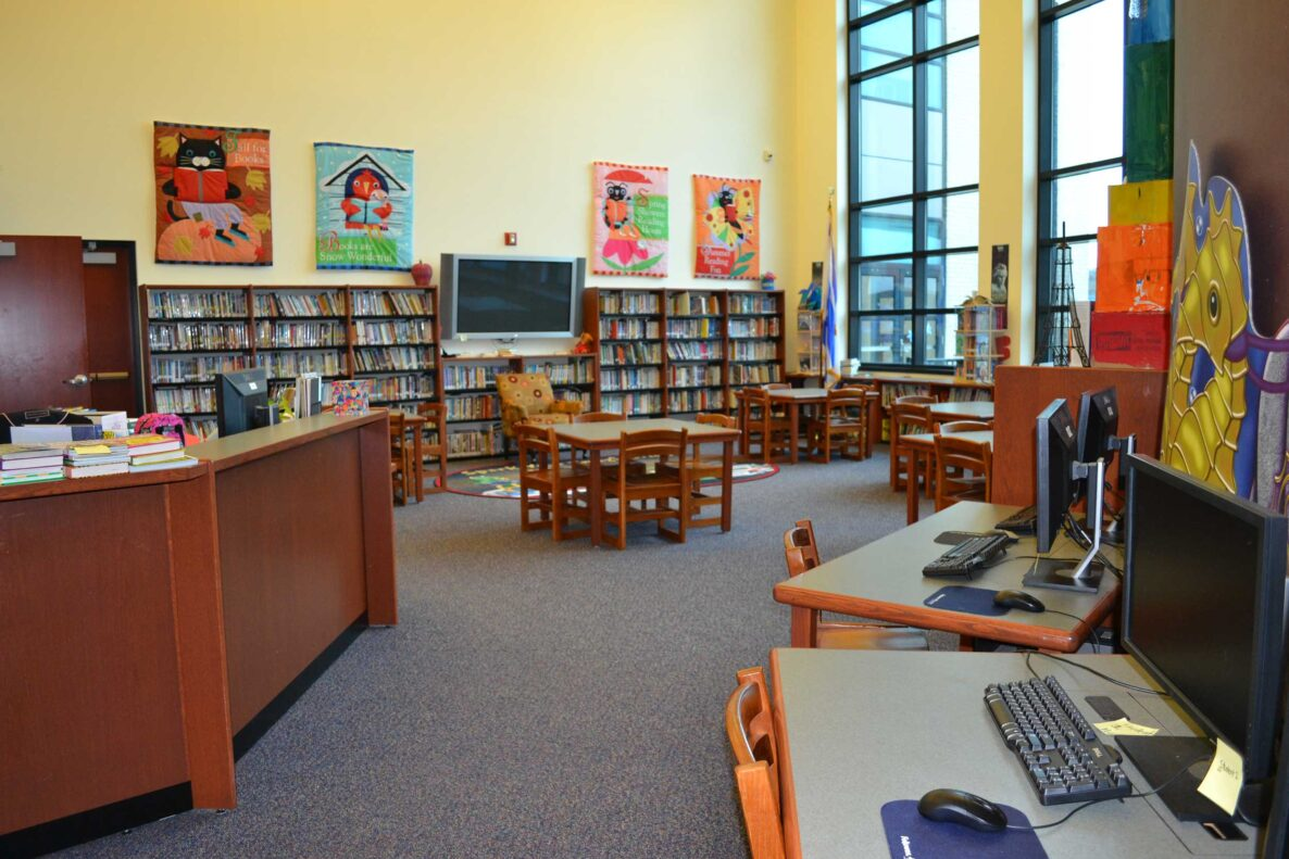 A library room filled with books and computers in an elementary school Norfolk VA