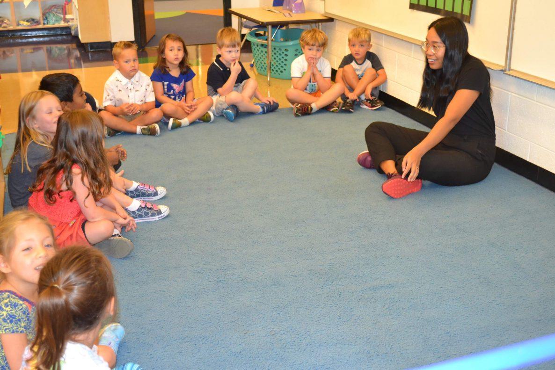 Teacher guiding small students at Strelitz International Academy