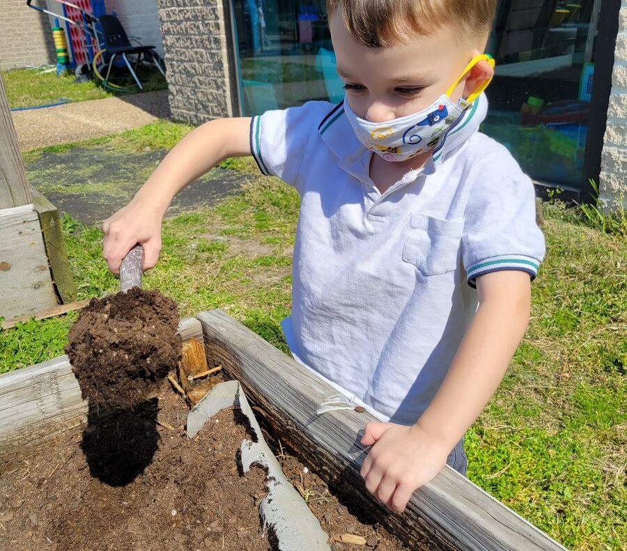 A kid practicing gardening activity