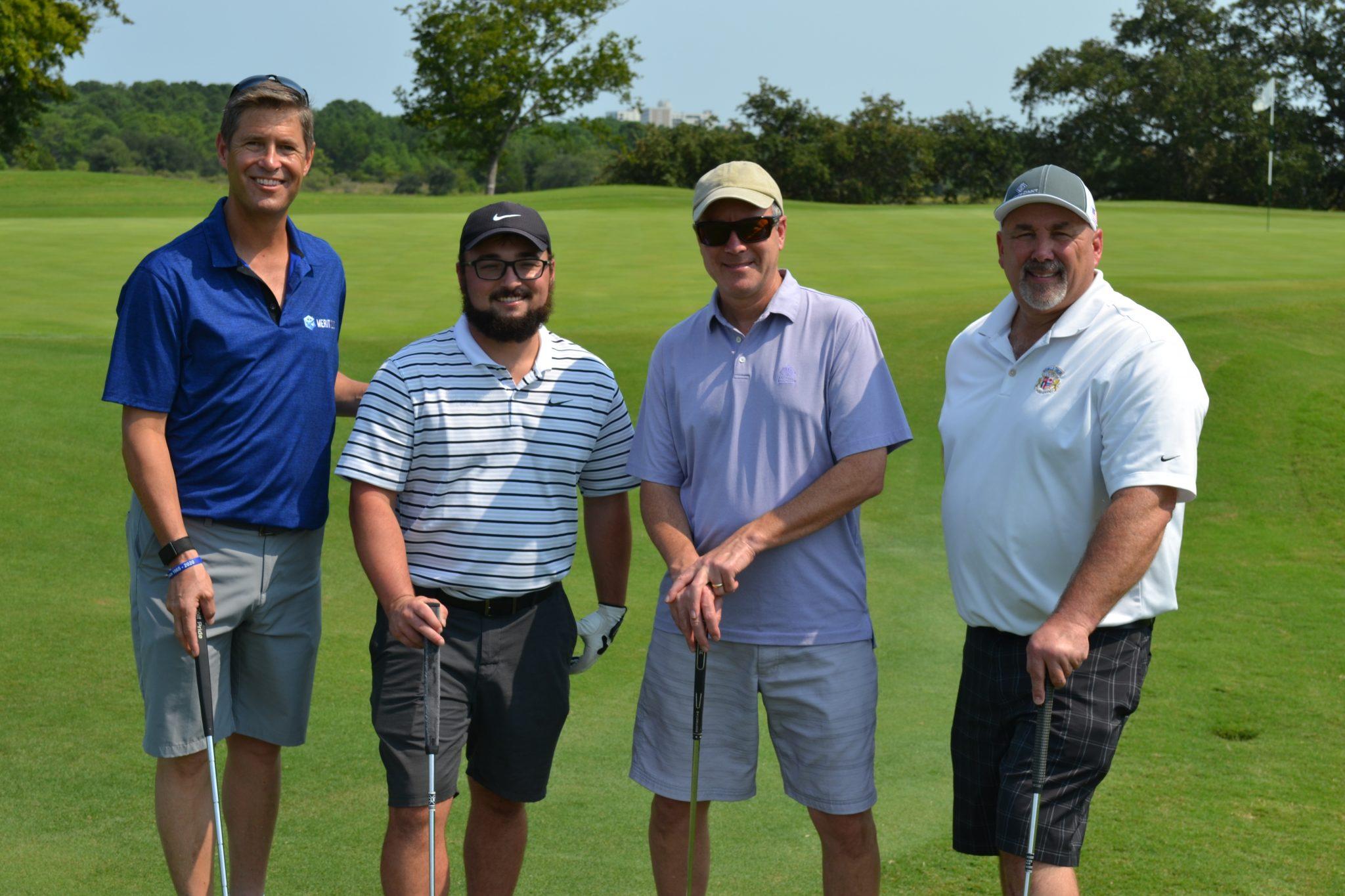 4 Gentlemen posing ater playing Golf in SIA's Golf Tournament